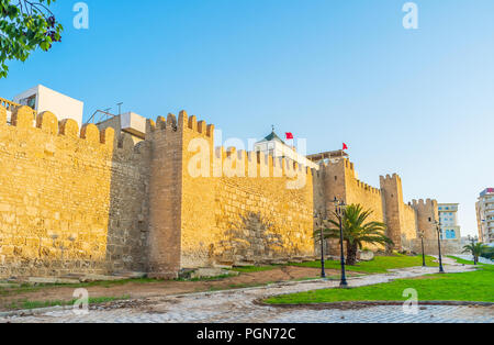 The huge city wall with small towers around the old Medina of Sousse, Tunisia. - Stock Photo