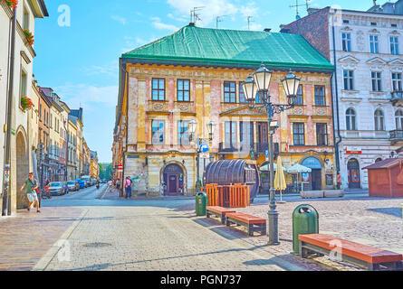 KRAKOW, POLAND - JUNE 11, 2018: Beautiful building in old Krakow facing to the Little Market Square (Maly Rynek) , on June 11 in Krakow. - Stock Photo