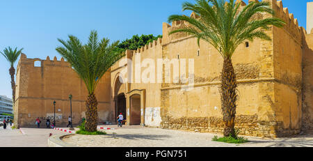 SFAX, TUNISIA - SEPTEMBER 3, 2015: Panorama of the fortress with massive walls, bastions and the gate, leading to Medina, on September 3 in Sfax. - Stock Photo