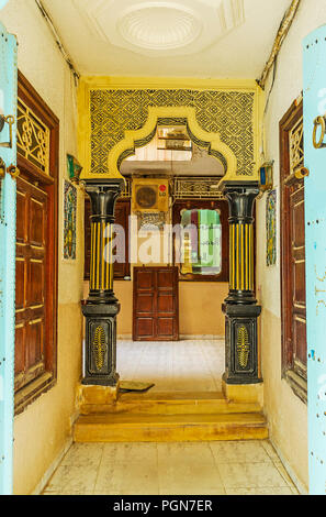 SOUSSE, TUNISIA - AUGUST 28, 2015: Reception hall of the small hotel, located in authentic Tunisian house in Medina, decorated with colored carved col - Stock Photo