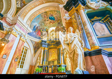 KRAKOW, POLAND - JUNE 11, 2018: The beautiful sculpture of the Archangel Michael and icon of Madonna and the Child on the backgroung, on June 11 in Kr - Stock Photo