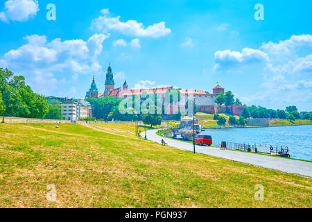 Promenade alond Vistula River is the best place to rest and relax with view on magnificent medieval Wawel Castle, Krakow, Poland - Stock Photo