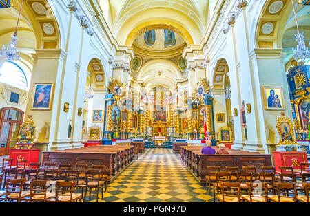 KRAKOW, POLAND - JUNE 11, 2018: Beautiful baroque style interior of St. Bernard of Siena Church with golden iconostasis, on June 11 in Krakow. - Stock Photo