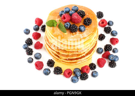 Pancakes stack with different berries and honey isolated on white background - Stock Photo