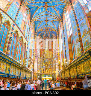 KRAKOW, POLAND - JUNE 11, 2018: The crowded chancel of St Mary Basilica with beautiful carved Altar on the background, on June 11 in Krakow. - Stock Photo