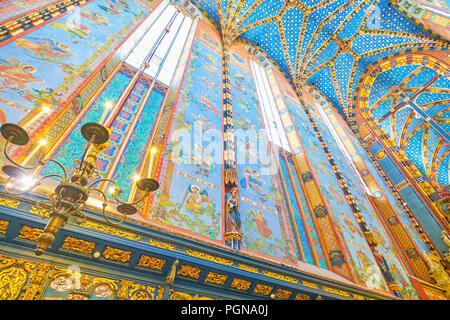 KRAKOW, POLAND - JUNE 11, 2018: The beautiful painted walls of Chancel of St Mary Basilica and fragment of vault of the nave, on June 11 in Krakow. - Stock Photo