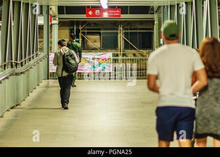 Bangkok, Thailand - February 21, 2017: Late night, People walk on sky walk way connect between Makkasan airport rail link station and Petchaburi MRT ( - Stock Photo