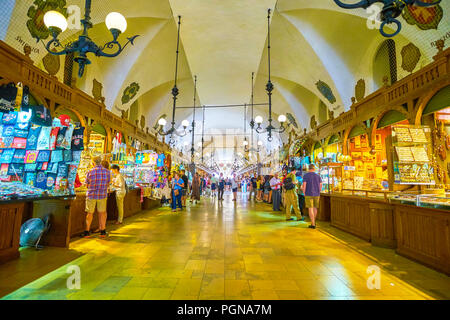 KRAKOW, POLAND - JUNE 11, 2018: The Cloth Hall is the medieval covered trade center in the heart of Krakow, nowadays is a home of main handicraft tour - Stock Photo