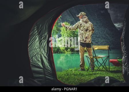 Fishing Camping Weekend. Caucasian Fisherman in Front of His Tent. - Stock Photo