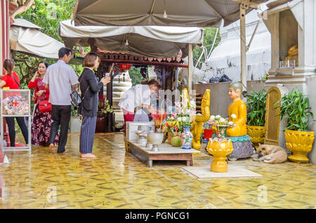 Phnom Penh, Cambodia - April 8, 2018: Devout  buddhists practicing their rituals in the Pagoda of Wat Phnom (Mountain Pagoda), the central point of Ph - Stock Photo