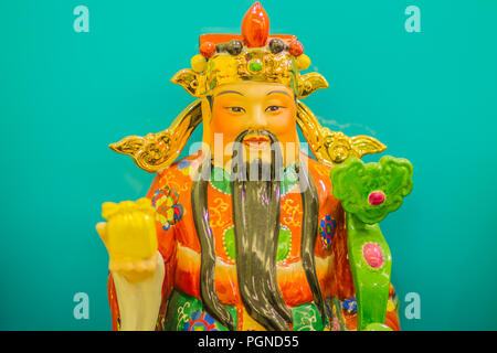 Close up sculpture of Cai Shen, Chinese God of wealth, God of fortune. - Stock Photo