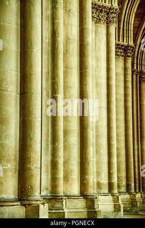 Close up of architectural detail of stone walls inside the Cathedral of Notre-Dame in Reims, France - Stock Photo