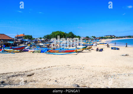 Fishing boats pulled up onto the sand Jimbaran beach, Bali, Indonesia - Stock Photo