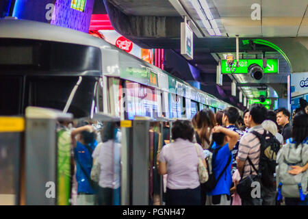 Bangkok, Thailand - February 28, 2017: Crowd of passengers on BTS Skytrain waiting for BTS at Siam station to continue to the BTS Silom line in this j - Stock Photo