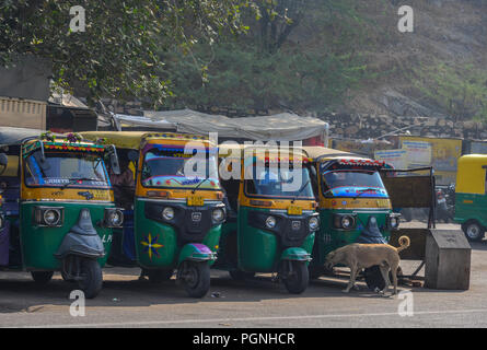 Jaipur, India - Nov 3, 2017. Tuk tuk taxis waiting on street in Jaipur, India. Auto rickshaws are used in cities and towns for short distances. - Stock Photo