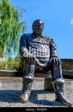Bronze statue of Dave Lee the famous pantomime dame outside the Marlowe theatre Canterbury - Stock Photo