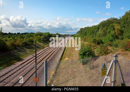 The high speed line through Kent alongside the M20 in Kent with double line and Overhead Line Equipment for power to traction untis running here. - Stock Photo