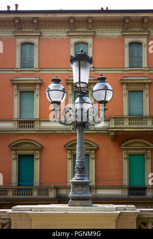 Street lamp and facade in Bologna, Italy - Stock Photo