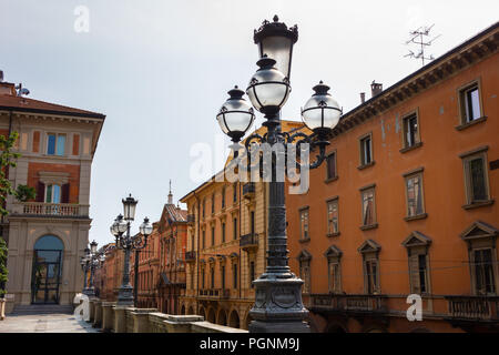 Street lamps and facades in Bologna, Italy - Stock Photo