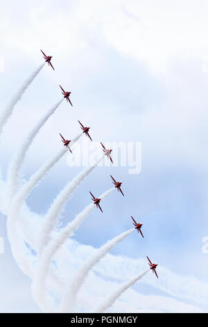 Royal Air Force Aerobatic Team, The Red Arrows, perform over RAF Syerston, 22 August 2018. - Stock Photo
