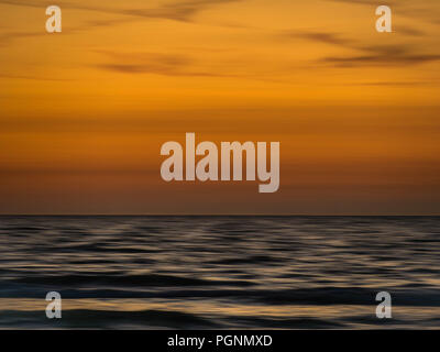 Abstract sunset with blurry waves in motion - Stock Photo