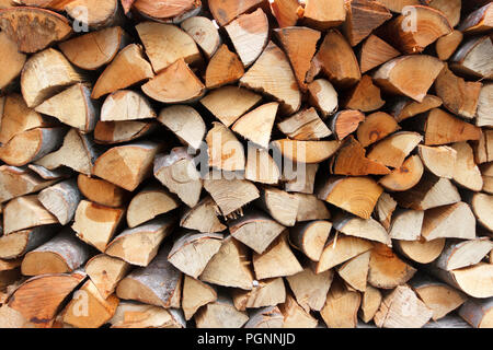 Dry chopped firewood logs ready for winter - Stock Photo