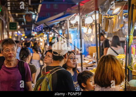 BANGKOK, THAILAND - JULY 12: View of stalls and tourists in the famous Rod Fai night market in Ratchada on July 12, 2018 in Bangkok - Stock Photo