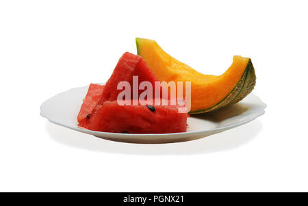 Slices of honeydew melon and watermelon isolated on white plate - Stock Photo