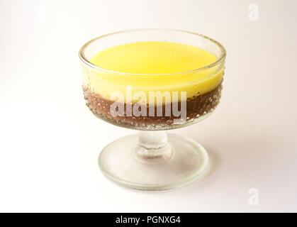 Mousse, pudding, souffle with vanilla and chocolate in glass white, bright background. - Stock Photo