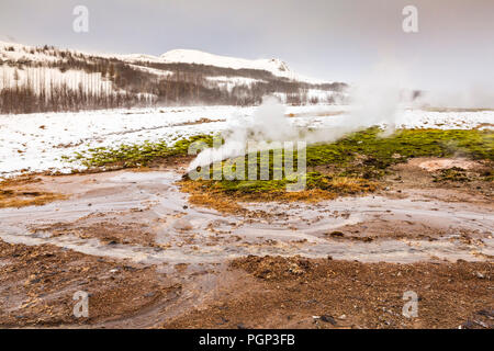 Geothermal landscape Strokkur Geysir in Winter. Located on the Golden circle, Geyir is a popular attraction for tourists. - Stock Photo