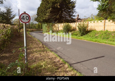 40 MPH speed limit sign on a countryside road in England, UK - Stock Photo