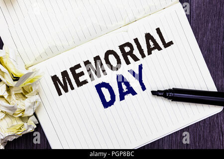 Conceptual hand writing showing Memorial Day. Business photo text To honor and remembering those who died in military service Marker over notebook cru - Stock Photo