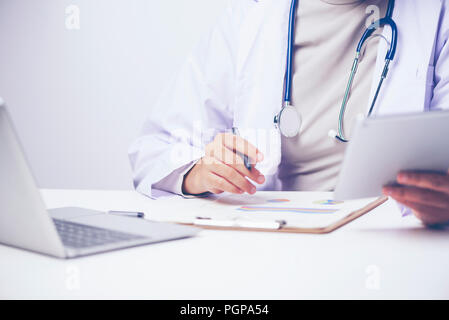 researchers Health care working in life science laboratory. Young female research scientist preparing and analyzing microscope slides in research lab - Stock Photo