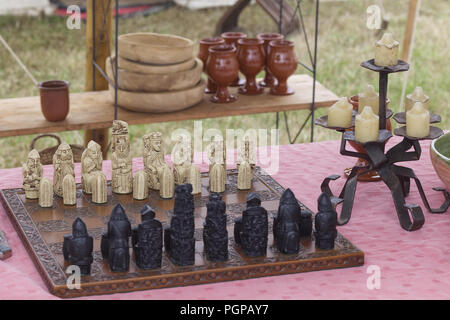 Medieval chess set on a banquet table - Stock Photo