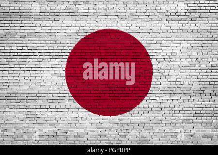 National flag of Japan on a brick background - Stock Photo