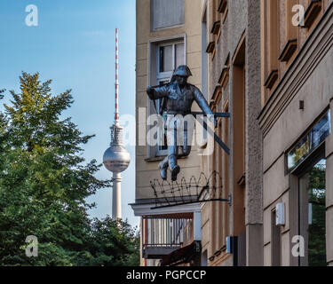 Berlin,Mitte.Conrad Schumann Memorial,Jumping soldier sculpture.East German Border guard, Conrad Schumann, jumps over barbed wire to escape from East - Stock Photo