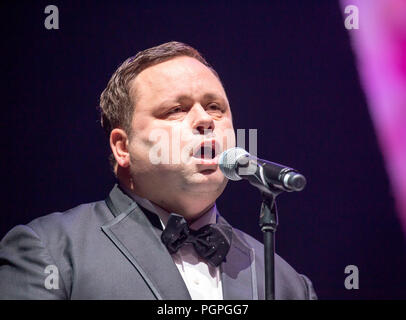 Seoul, South Korea. 27th Aug 2018. Paul Potts, Aug 27, 2018 : British tenor Paul Potts performs during a mass wedding ceremony of the Unification Church at the CheongShim Peace World Center in Gapyeong, about 60 km (37 miles) northeast of Seoul, South Korea. Four thousand newlywed couples from around the world participated in the mass wedding on Monday, which was organized by Hak Ja Han Moon, wife of the late Reverend Moon. Credit: Aflo Co. Ltd./Alamy Live News - Stock Photo