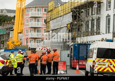 Aberystwyth Wales UK,Tuesday 28 August 2018  Five weeks after the devastating fire that destroyed the Belgrave House Hotel and seriously damaged the adjoining Belle Vue hotel on Aberystwyth's seafront, specialist Urban Search And Rescue teams are at last able to enter the site.  One person from Lithuania  is reported as still missing and the search will now begin of the ruined buildings. A local man, Damion Harris, aged 30, appeared before Swansea Crown Court on Friday, charged with arson with intent to endanger life.  photo © Keith Morris/Alamy Live News - Stock Photo