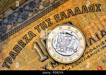 Greek 1 Euro coin on a 1941 1000 Drachma Greek banknote - Stock Photo
