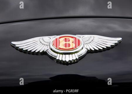 UK, England, Cheshire, Stockport, Woodsmoor Car Show, flying B badge on bonnet of Bentley Flying Spur car - Stock Photo