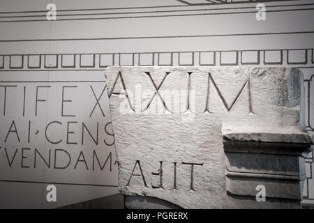 Carved in stone, Roman text on broken stone tablets. - Stock Photo