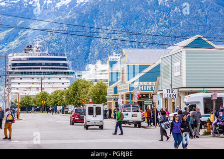 Cruise liners in the harbour very close to the tourist shops in the main street in Skagway, Alaska USA - Stock Photo