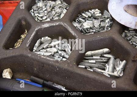 Tyre/tire fitting: a selection tyre weights to aid wheel balancing - Stock Photo