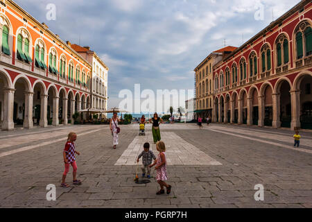 Children play in the grand Trg Republike, popularly known as Prokurative, Split, Croatia - Stock Photo