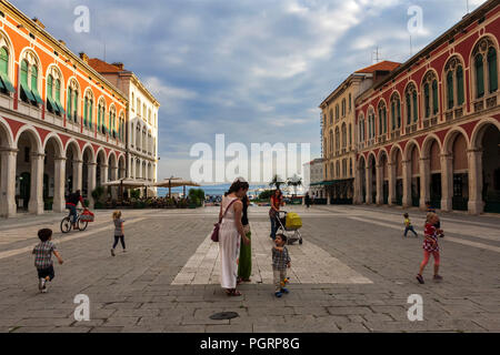 Children and mums in the grand Trg Republike, popularly known as Prokurative, Split, Croatia - Stock Photo