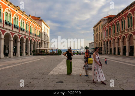 Mothers and children in the grand Trg Republike, popularly known as Prokurative, Split, Croatia - Stock Photo
