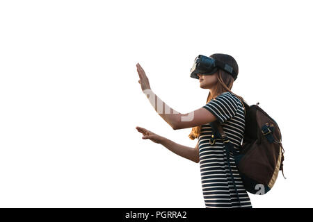 Girl with a backpack in virtual glasses is isolated on white background. Virtual travel with the help of new technologies. - Stock Photo