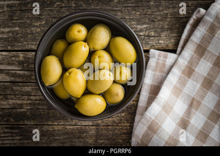 The green olives in bowl. - Stock Photo