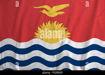 Fabric texture of the flag of Kiribati waving. - Stock Photo