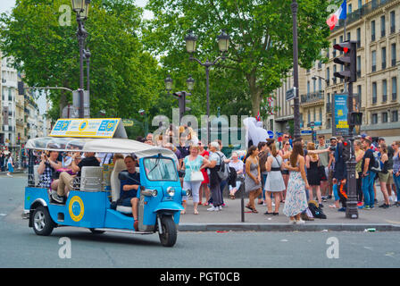 People in front of Moulin Rouge, Place Blanche, Pigalle, Paris, France - Stock Photo
